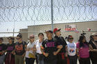 Demonstrators line up alongside a fence inside the Otay Mesa Detention Center in San Diego on June 23 during a rally in support of immigrant families who had been separated at the U.S.-Mexico border. (CNS photo/David Maung)