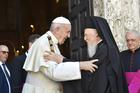 Pope Francis greets Ecumenical Patriarch Bartholomew of Constantinople outside the Basilica of St. Nicholas in Bari, Italy, July 7, 2018.