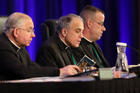 Cardinal Daniel N. DiNardo of Galveston-Houston, center, leads the opening prayer Nov. 12 during the fall general assembly of the U.S. Conference of Catholic Bishops in Baltimore. Also pictured are Archbishop Jose H. Gomez of Los Angeles, vice president of the USCCB, and Msgr. J. Brian Bransfield, general secretary. (CNS photo/Bob Roller)