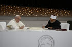 Pope Francis and Sheik Ahmad el-Tayeb, grand imam of Egypt's al-Azhar mosque and university, sign documents during an interreligious meeting at the Founder's Memorial in Abu Dhabi, United Arab Emirates, on Feb. 4, 2019. (CNS photo/Paul Haring)