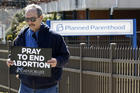 Pro-life advocate Joe San Pietro participates in a 40 Days for Life vigil near the entrance to a Planned Parenthood center in Smithtown, N.Y., on March 26. (CNS photo/Gregory A. Shemitz)