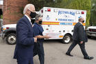 Democratic presidential candidate former Vice President Joe Biden arrives with pizza as he visits Pittsburgh Local Fire Fighters No. 1 in Pittsburgh, Pa., Monday, Aug. 31, 2020. (AP Photo/Carolyn Kaster)
