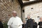 Pope Francis greets religious as he leaves the hermitage and cell of St. Francis in Assisi, Italy, in this Oct. 4, 2013, file photo. The pope plans to visit Assisi on Oct. 3 to celebrate a private Mass and sign his new encyclical on human fraternity. (CNS photo/Paul Haring)