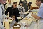 Volunteers serve breakfast to the needy at a shelter in Mount Clemens, Mich. (CNS photo/Jim West)