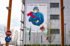 A mural depicts a nurse embracing the shape of Italy posted on the hospital of Pope John XXIII in solidarity with the health workers in Bergamo on March 13, 2020. (CNS photo/Sergio Agazzi, IPA/ABACAPRESS.COM via Reuters)