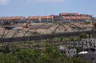 New housing units being built in the Israeli settlement Efrat are seen on the hillside overlooking a Palestinian village near Bethlehem, West Bank, May 10, 2020. The Vatican issued a statement May 20 stating concerns about an Israeli plan to unilaterally annex a large portion of land in the West Bank. (CNS photo/Debbie Hill)