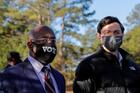 Democratic U.S. Senate candidates Rev. Raphael Warnock and Jon Ossoff appear together at a campaign rally in Augusta, Ga., Jan. 4, 2021.