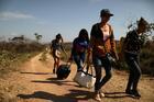 Venezuelan migrants walk along a trail into Brazil, in the border city of Pacaraima, Brazil, in April 2019. (CNS photo/Pilar Olivares, Reuters)