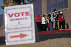 People wait in line at a polling place on Nov. 3, 2020, in Las Vegas. (AP Photo/John Locher, File)