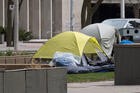 Homeless camp set up in a park in the middle of University Avenue in downtown Toronto near the courthouse during the Covid-19 pandemic on April 3, 2020.