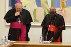 Archbishop Arthur Roche, then secretary of the congregation, left, andCardinal Robert Sarah, then prefect of the Congregation for Divine Worship and the Sacraments, pray with U.S. bishops at the start of a meeting at the congregation at the Vatican on Jan. 14, 2020. (CNS photo/Paul Haring)
