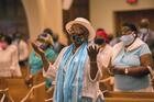 Faithful in Miami sing during Mass at St. Mary Cathedral on the feast of the Assumption, Aug. 15, 2021. (CNS photo/Marlene Quaroni, Florida Catholic)