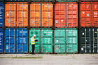 The development of the shipping container in the 1960s cut the cost of ocean shipping and permitted a colossal boom in global trade. (iStock/Yuri_Arcurs)