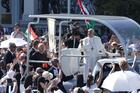 Pope Francis greets the crowd as he arrives to celebrate the closing Mass of the International Eucharistic Congress at Heroes' Square in Budapest, Hungary, Sept. 12, 2021. Also pictured in the popemobile is Cardinal Péter Erdo of Esztergom-Budapest. (CNS photo/Paul Haring)