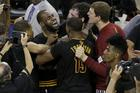 Cleveland Cavaliers forward LeBron James (23) hugs Kyrie Irving after Game 7 of basketball's NBA Finals against the Golden State Warriors. The Cavaliers won 93-89. (AP Photo/Eric Risberg)