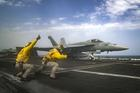 "ARABIAN SEA (May 16, 2019) Lt. Nicholas Miller, from Spring, Texas, and Lt. Sean Ryan, from Gautier, Miss., launch an F/A-18E Super Hornet from the ""Pukin' Dogs"" of Strike Fighter Squadron (VFA) 143 on the flight deck of the Nimitz-class aircraft carrier USS Abraham Lincoln (CVN 72). (U.S. Navy photo by Mass Communication Specialist 3rd Class Jeff Sherman/Released)"