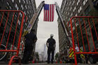 Firefighters attend a Sept. 11 ceremony in Exchange Place, N.J., marking the 13th anniversary of the 9/11 terrorist attacks on the World Trade Center (CNS photo/Eduardo Munoz, Reuters).