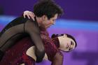 Scott Moir and Tessa Virtue of Canada perform in the ice dance free dance figure skating team event at the 2018 Winter Olympics in Gangneung, South Korea, Monday, Feb. 12 (AP Photo/Julie Jacobson).