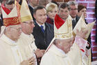 In this file photo taken on April 14, 2017, Polish bishops walk by President Andrzej Duda, First Lady Agata Kornhauser-Duda, parliament speakers and Prime Minister Beata Szydlo as they arrive to celebrate a special Mass during ceremonies marking 1,050 years of the nation's Catholicism at the 10th-century cathedral in Gniezno,Poland considered to be the cradle of Poland's Catholic faith. (AP Photo/Czarek Sokolowski)