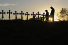 Isaac Hernandez and his wife Crystal visit a line of crosses before a vigil for the victims of the First Baptist Church shooting, Monday, Nov. 6, 2017, in Sutherland Springs, Texas. (AP Photo/David J. Phillip)