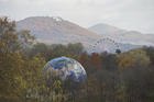 A globe and a Ferris Wheel stand in the forest near Bonn, Germany, on Monday, Nov. 13, 2017. The UN Climate Conference takes place in Bonn, Germany till Nov. 17, 2017. (Rainer Jensen/dpa via AP)