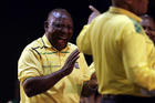 South African Deputy President, Cyril Ramaphosa, laughs at President Jacob Zuma, right, at the start of the ruling African National Congress elective conference in Johannesburg on Dec. 16. (AP Photo/Themba Hadebe, File)