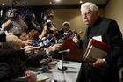 In this Tuesday, Nov. 12, 2002 file photo, Cardinal Bernard Law, right, departs a news conference during the second day of the U.S. Conference of Catholic Bishops annual meeting in Washington (AP Photo/Ken Lambert, File).