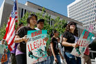 In this June 15, 2010, file photo, immigration reform advocates march around the Federal Courthouse in downtown Denver. (AP Photo/David Zalubowski, File)