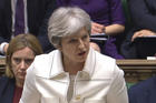 Britain's Prime Minister Theresa May makes a statement in the House of Commons on April 16 regarding her decision to join air strikes against Syria. (PA via AP)