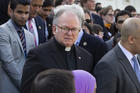 In this June 2016 photo, Patrick Conroy, S.J., chaplain of the House of Representatives, delivers an interfaith message on the steps of the Capitol in Washington for the victims of the mass shooting at an LGBT nightclub in Orlando. (AP Photo/J. Scott Applewhite)