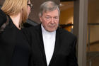 Australian Cardinal George Pell leaves the Melbourne Magistrate Court in Melbourne Tuesday, May 1, 2018. (AP Photo/Andy Brownbill)