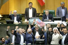 Iranian lawmakers burn papers representing the U.S. flag and the international nuclear agreement at the parliament in Tehran on May 9, following President Trump's announcement that the United States will withdraw from the deal. (AP Photo)