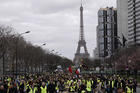 Yellow Vest Protesters march near the Eiffel Tower in Paris on March 2. (AP Photo/Kamil Zihnioglu)