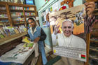 A Catholic sister browses in a store with Pope paraphernalia in Antananarivo, Madagascar, on Sept. 3. (AP Photo/Alexander Joe)