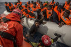 In this Sunday, Feb 18, 2018 file photo, refugees and migrants are rescued by aid workers of the Spanish NGO Proactiva Open Arms, after leaving Libya trying to reach European soil aboard an overcrowded rubber boat, 60 miles north of Al-Khums, Libya. (AP Photo/Olmo Calvo, file)