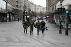 In this March 26, 2020, photo, Serbian army soldiers patrol Belgrade's main pedestrian street as part of the government's efforts to contain the coronavirus pandemic. (AP Photo/Darko Vojinovic)