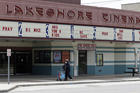 Should the U.S. reopen all at once or one screen at a time? A woman walks past the closed Lakeshore Cinema in Euclid, Ohio, on May 6. (AP Photo/Tony Dejak)