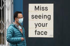 """Should I wear a mask to the grocery store?"" is one of the new questions about our responsibilities to others. Photo taken outside a business in San Francisco on April 11. (AP Photo/Jeff Chiu, File)"