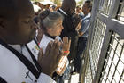 Faith leaders pray at the main entrance to the Otay Mesa Detention Center in San Diego June 23 during a march and rally in support of immigrant families who had been separated at the U.S.-Mexico border. (CNS photo/David Maung, EPA)