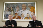 Auxiliary Bishop Fernando Ramos Perez of Santiago, Chile, and Bishop Juan Ignacio Gonzalez Errazuriz of San Bernardo, Chile, lead a press conference at the Vatican May 14. Pope Francis is meeting this week with Chile's bishops in the wake of a clerical sex abuse crisis. (CNS photo/Paul Haring)