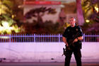 A police officer stands in front of the Tropicana hotel-casino in Las Vegas Oct. 2 after a mass shooting at a music festival. A gunman perched on the 32nd floor of a hotel unleashed a shower of bullets late Oct. 1 on an outdoor country music festival below, killing more than 50 people and wounding hundreds, making it the worst mass shooting in modern U.S. history (CNS photo/Steve Marcus, Las Vegas Suns).