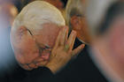 Boston Cardinal Bernard F. Law bows his head as a victim of clergy sexual abuse begins to address the U.S. bishops in 2002 in Dallas (CNS photo by Bob Roller).