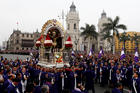 "Men carry a replica of Peru's most revered religious icon, the ""Lord of Miracles,"" during an Oct. 18, 2017 procession in Lima. Each year thousands of Catholics gather to commemorate the image's survival in a 17th-century earthquake that destroyed Lima. (CNS photo/Mariana Bazo, Reuters)"