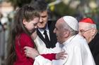 Pope Francis greets a girl during a March 12 visit at the Rome parish of St. Magdalene of Canossa. (CNS photo/Angelo Carconi, EPA)