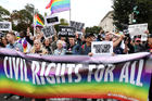 """Activists and supporters block the street outside the U.S. Supreme Court in Washington Oct. 8, 2019, as it hears arguments in three major employment discrimination cases on whether federal civil rights law prohibiting workplace discrimination on the """"basis of sex"""" covers gay and transgender employees. (CNS photo/Jonathan Ernst, Reuters)"""