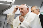 WHO AM I TO JUDGE? Pope Francis aboard the papal flight from Rio de Janeiro to Rome, July 28.
