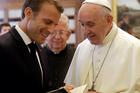 Pope Francis exchanges gifts with French President Emmanuel Macron during a private audience at the Vatican inJune 2018. (CNS photo/ Alessandra Tarantino, pool via Reuters)