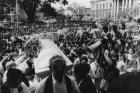 Thousands gather outside the Metropolitan Cathedral in San Salvador March 30, 1980, as the casket of slain Archbishop Oscar Romero is carried inside for a funeral Mass.