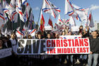 Christians who had fled the unrest in Syria and Iraq demonstrate in Beirut in February 2015. (CNS photo/Nabil Mounzer, EPA)