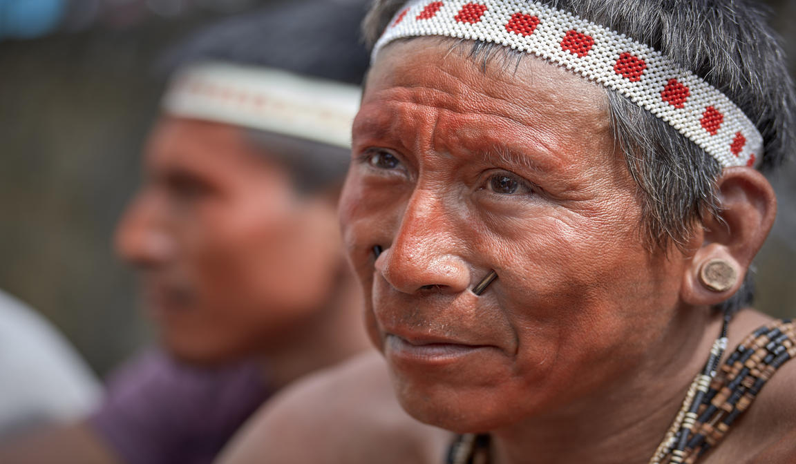 His face painted red with urucum, a man participates in a march by indigenous people through the streets of Atalaia do Norte in Brazil's Amazon region on March 27, 2019. Indigenous were protesting a central government plan to turn control of health care over to municipalities, in effect destroying a federal program of indigenous health care. (CNS photo/Paul Jeffrey)